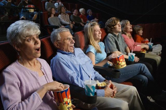 People Watching Movie in Movie Theatre