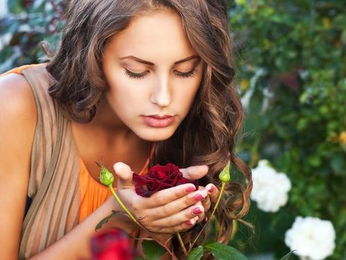woman-smelling-rose